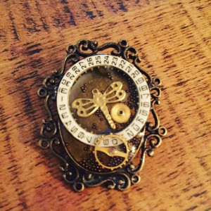 Some_items_I_m_adding_to_my_Etsy_shop_today.__Here_s_a_Steampunk_assemblage_dragonfly__brooch_made_with_vintage_mechanical_watch_parts. (2)